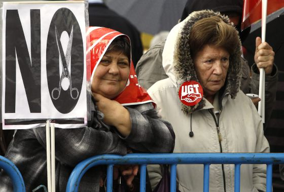 Two women taking part in the demonstrations in Madrid on Tuesday.