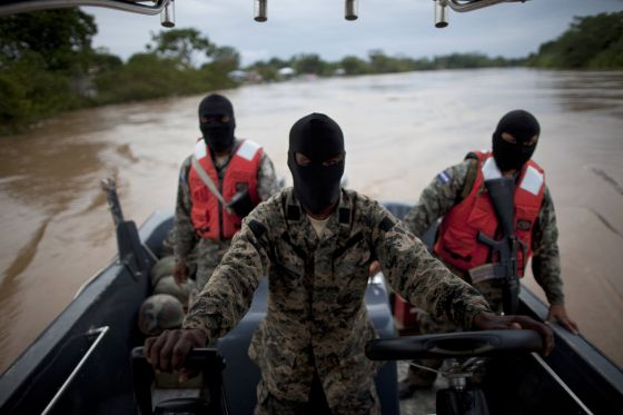Honduran navy officers patrol the Patuca River near where last week's shooting incident occurred.
