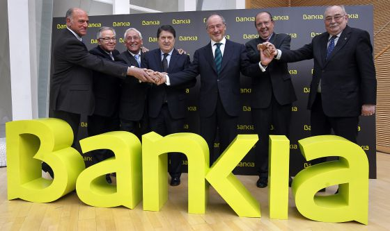 Caja Madrid Chairman Rodrigo Rato (center) in March 2011 with the chiefs of the six other savings banks which made up Bankia. Just over a year after it would be nationalized