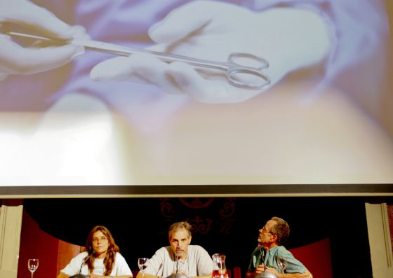 Fernando Colomo (right) looks up at the screen during the presentation of his short protest film last week.