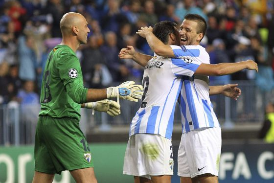 Málaga players Caballero, Jesús Gámez and Ignacio Camacho celebrate the team's 1-0 win over Milan.