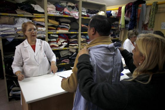 Inside the Red Cross charity shop in the Madrid satellite town of Alcorcón.
