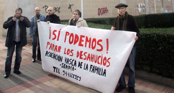 Members of the Basque Family Association hold a protest where the woman died in Barakaldo Friday.