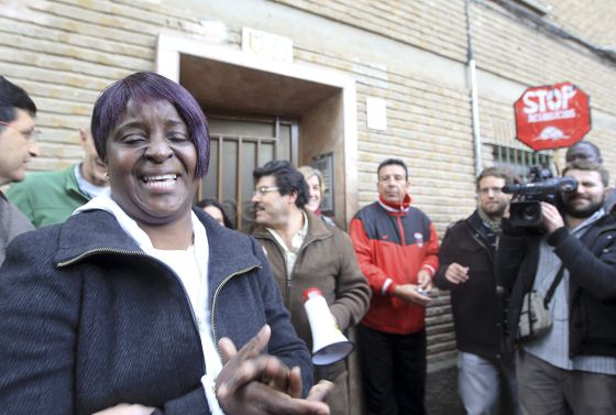 A woman bursts into tears after an eviction against her is stopped in Zaragoza Thursday.