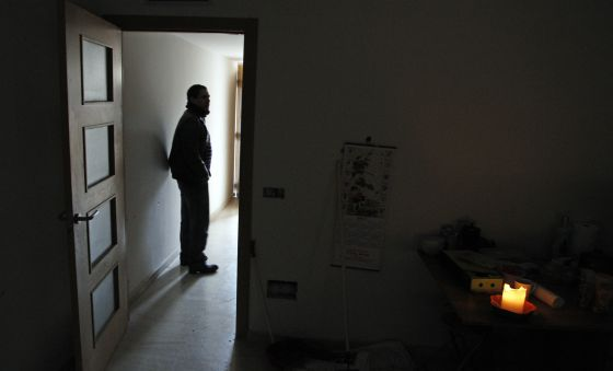 One of Valdemoro's illegal tenants, in the property that he is fixing up himself.