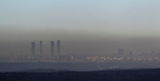 Pollution over the Madrid skyline: experts say traffic has to be reduced to bring down ozone levels.