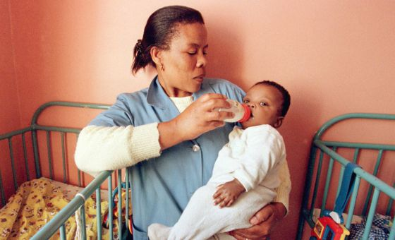 A nurse in Johannesburg feeds an HIV-infected child.